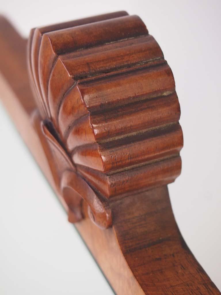 Vintage walnut framed shell carved mirror