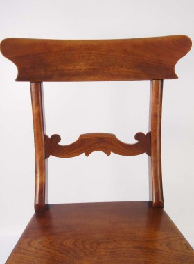 A stylish pair of antique Victorian kitchen chairs or hall chairs.