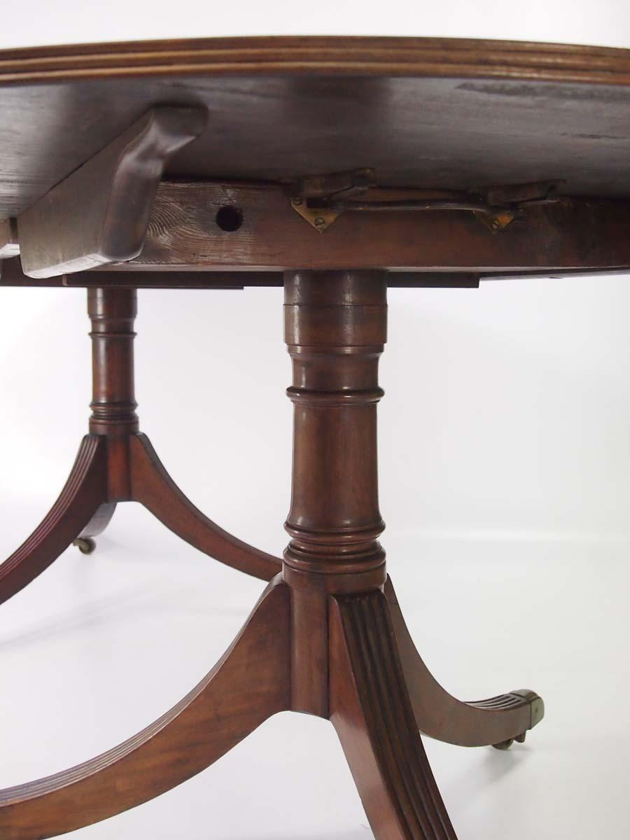 Antique Twin Pillar Mahogany Extending Dining Table